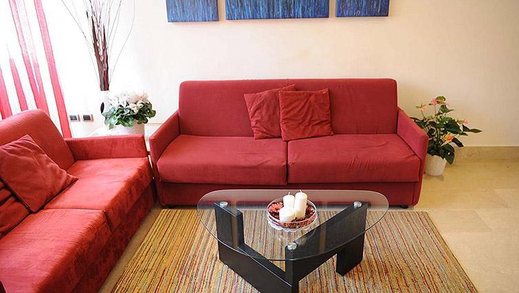 Large living area at Lux Appartamenti Rome