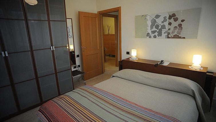 Colourful bedroom at Lux Appartamenti Rome