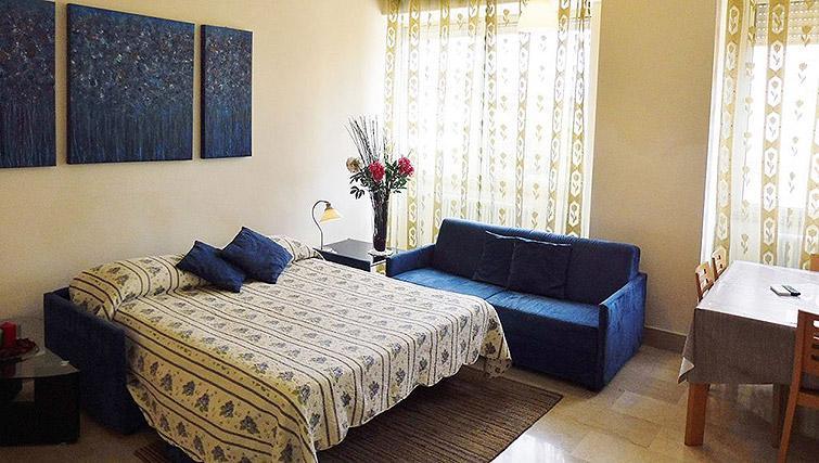 Sofa bed at Lux Appartamenti Rome