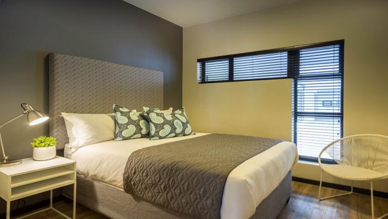 Double bed at The Vantage Apartments
