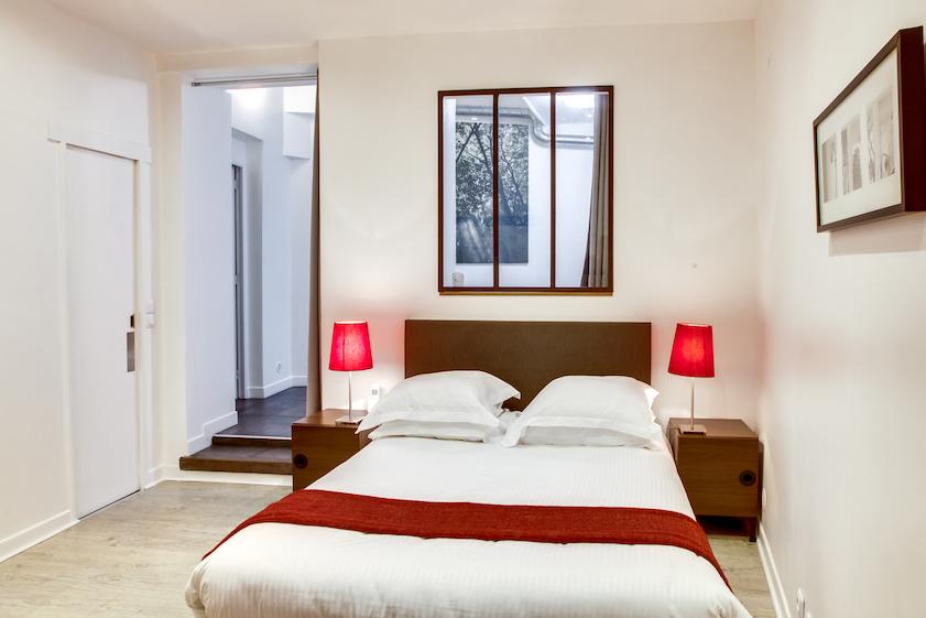 Cosy bedroom at Rue d'Argout Apartments