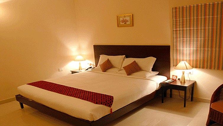 Serene bedroom in Residency Road Apartments
