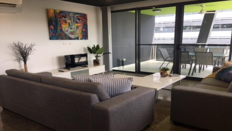 Living room at RNR Darwin Serviced Apartments