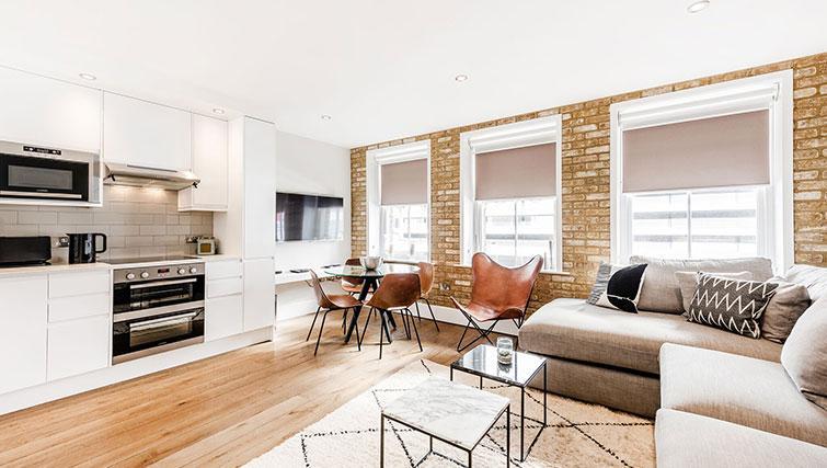 Spacious living area at BE: Drury Lane Apartments