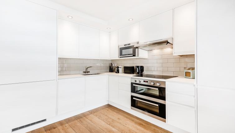 Kitchen at BE: Drury Lane Apartments