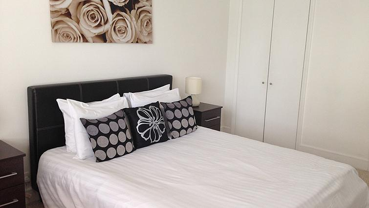 Cosy bedroom at Belgrave Court Apartments