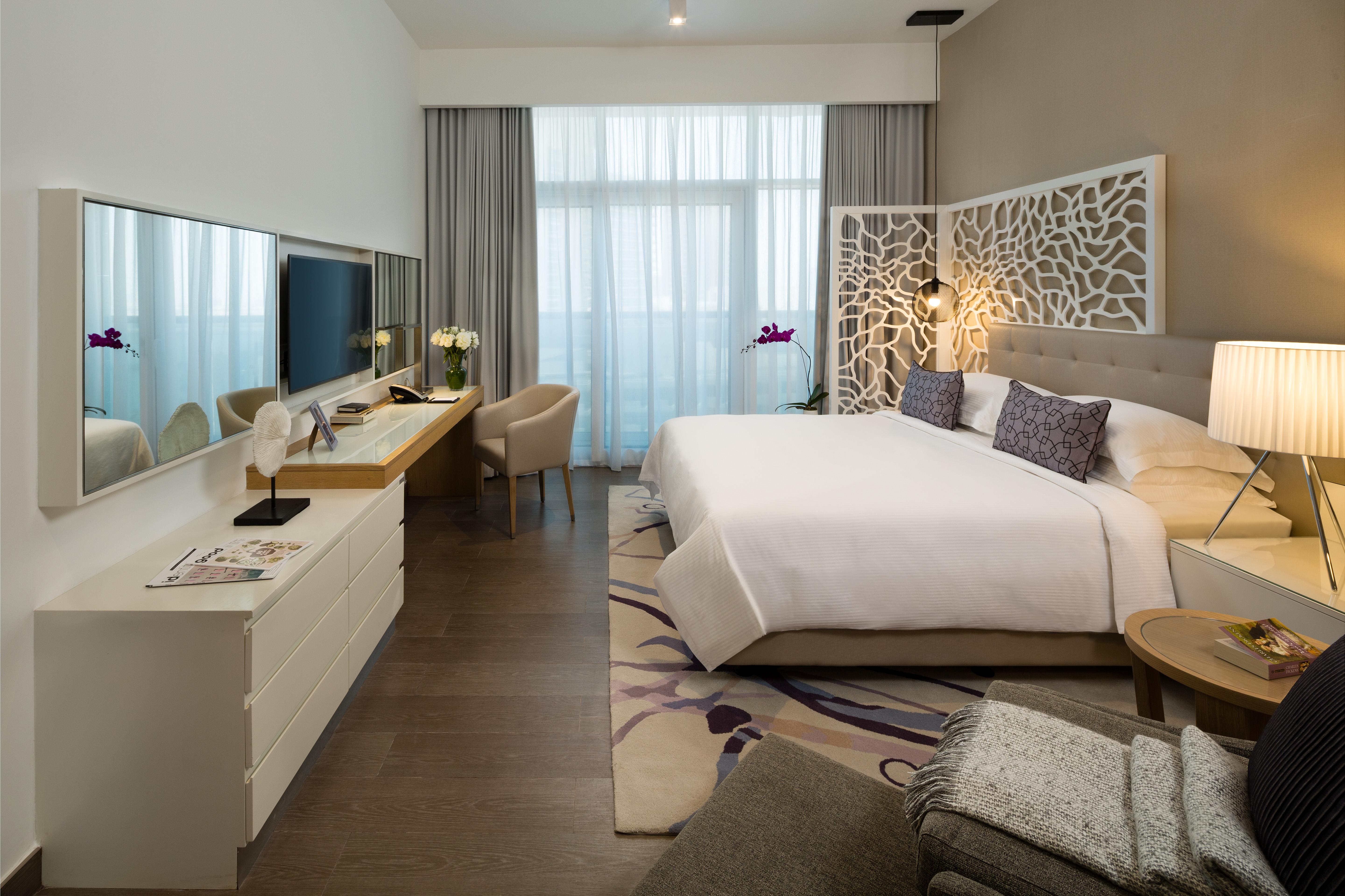 Bright bedroom at Beach Rotana Residences
