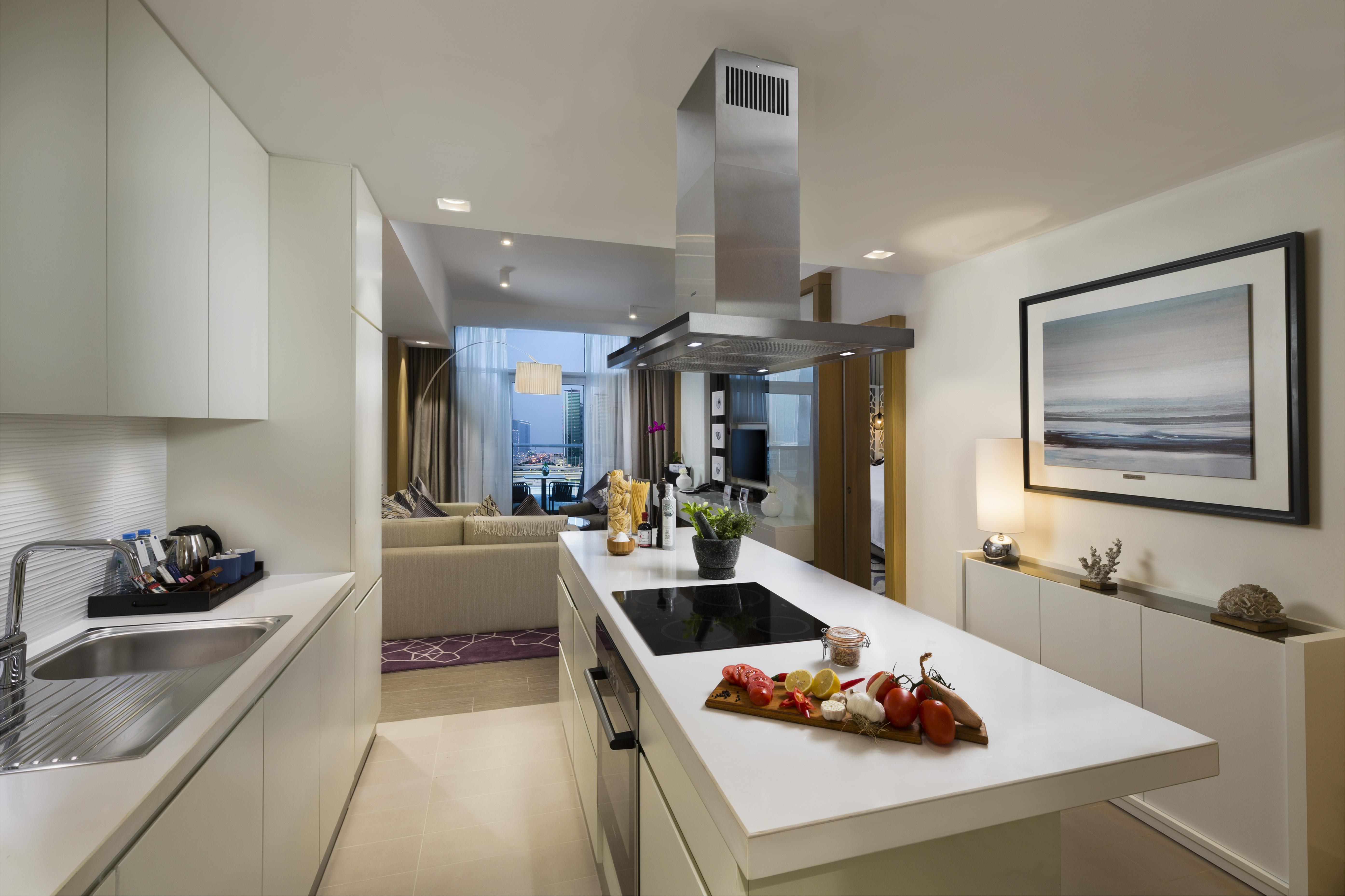 Sleek kitchen at Beach Rotana Residences