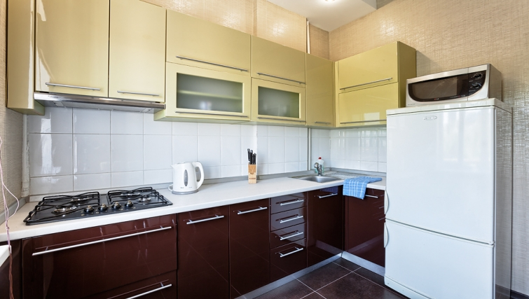Compact kitchen at Kreschatic Apartments