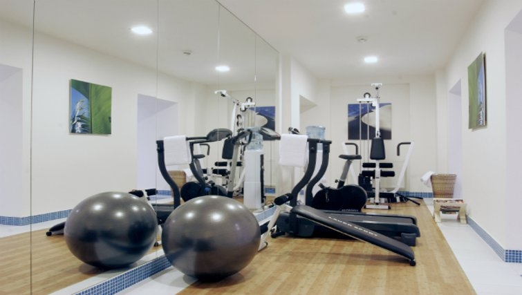 Inviting gym at Mamaison Residence Sulekova