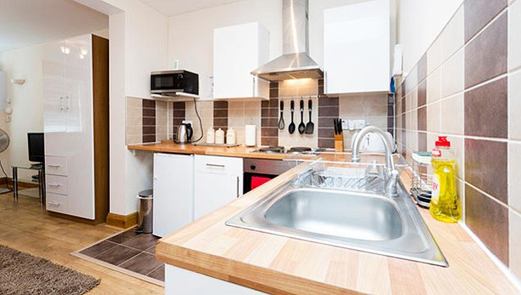 Fully equipped kitchen at Heathrow Apartments