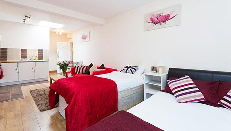 Open plan bedroom at Heathrow Apartments
