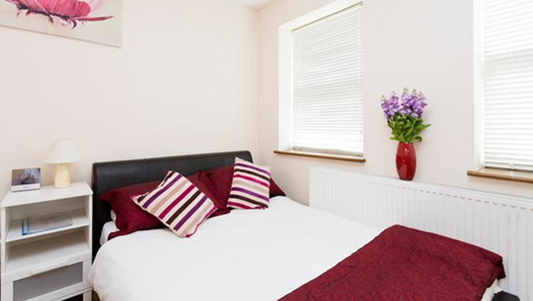 Bright bedroom at Heathrow Apartments