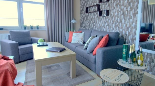 Grey sofa at White Wood Apartment, Centre, Gdansk