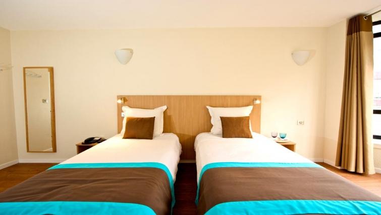 Sleek bedroom in Gare de L'Est Apartments