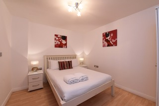 Cosy bedroom at Deansgate Apartments, Deansgate, Manchester