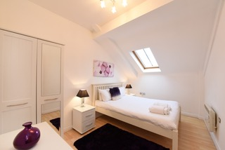 Plush bedroom at Deansgate Apartments, Deansgate, Manchester