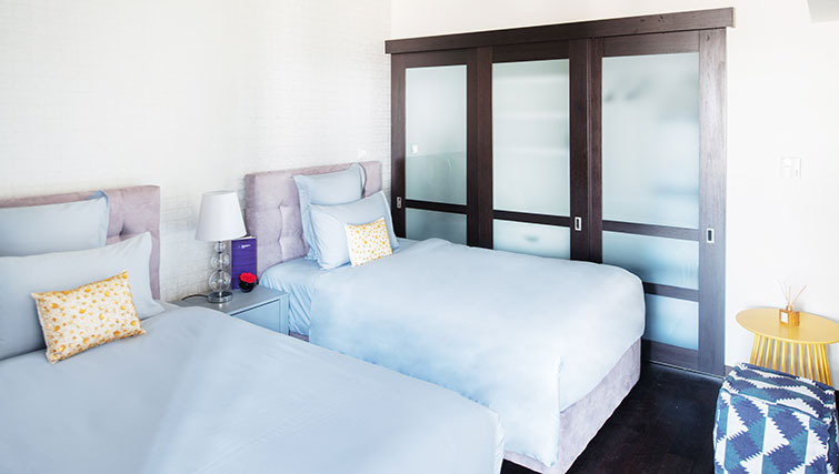 Twin beds at Loft Towers Apartments