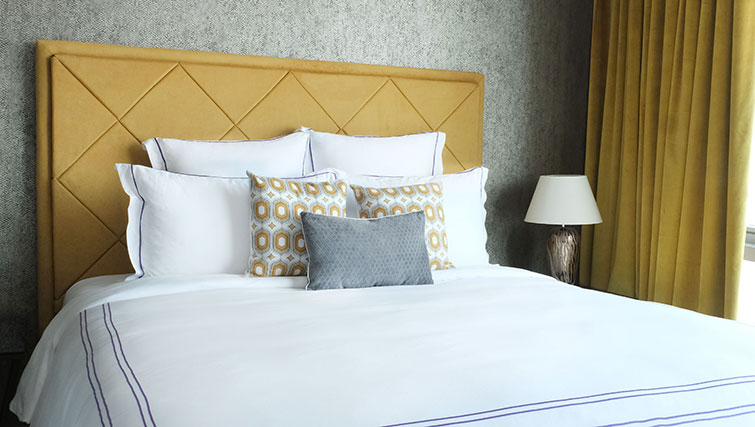 King size bed at Loft Towers Apartments