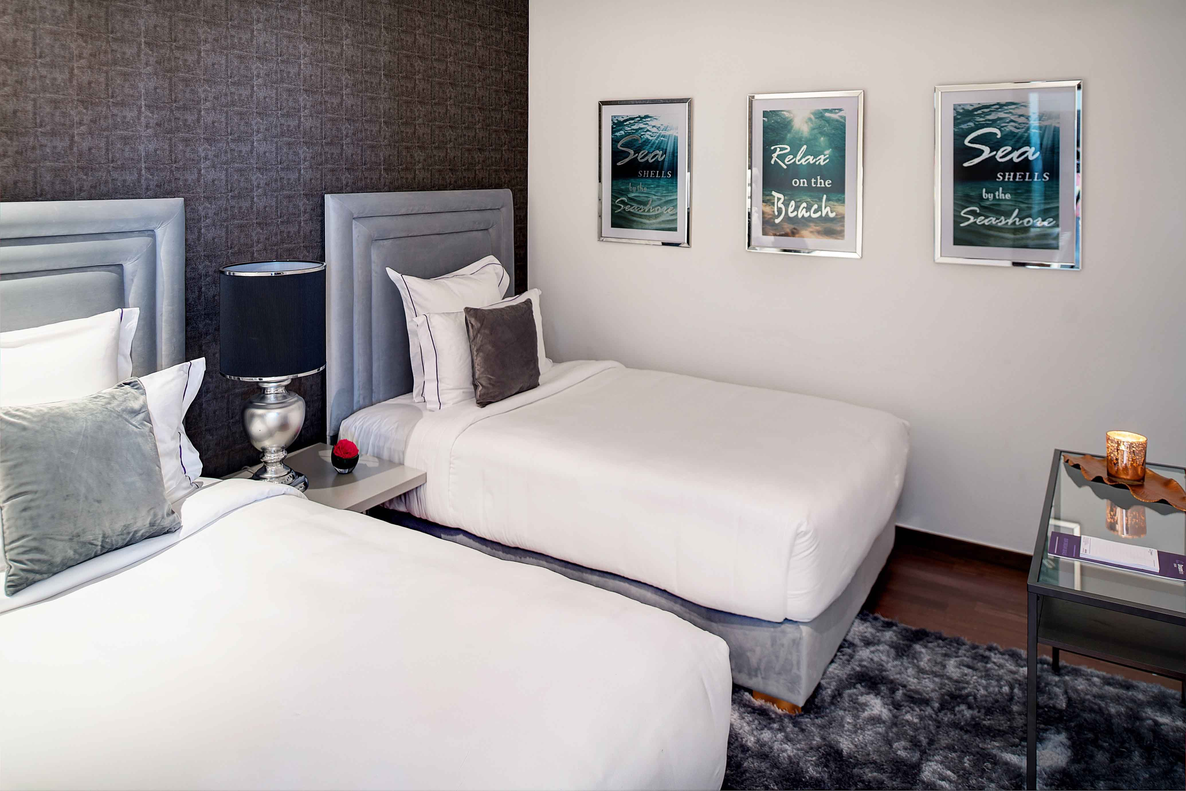 Twin beds at Tiara Tower Apartments