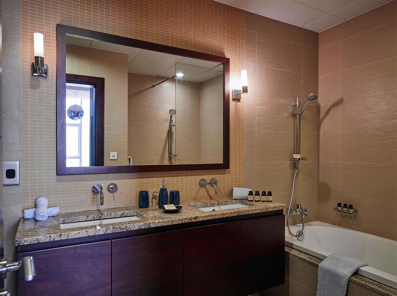 Bath and shower at Tiara Tower Apartments