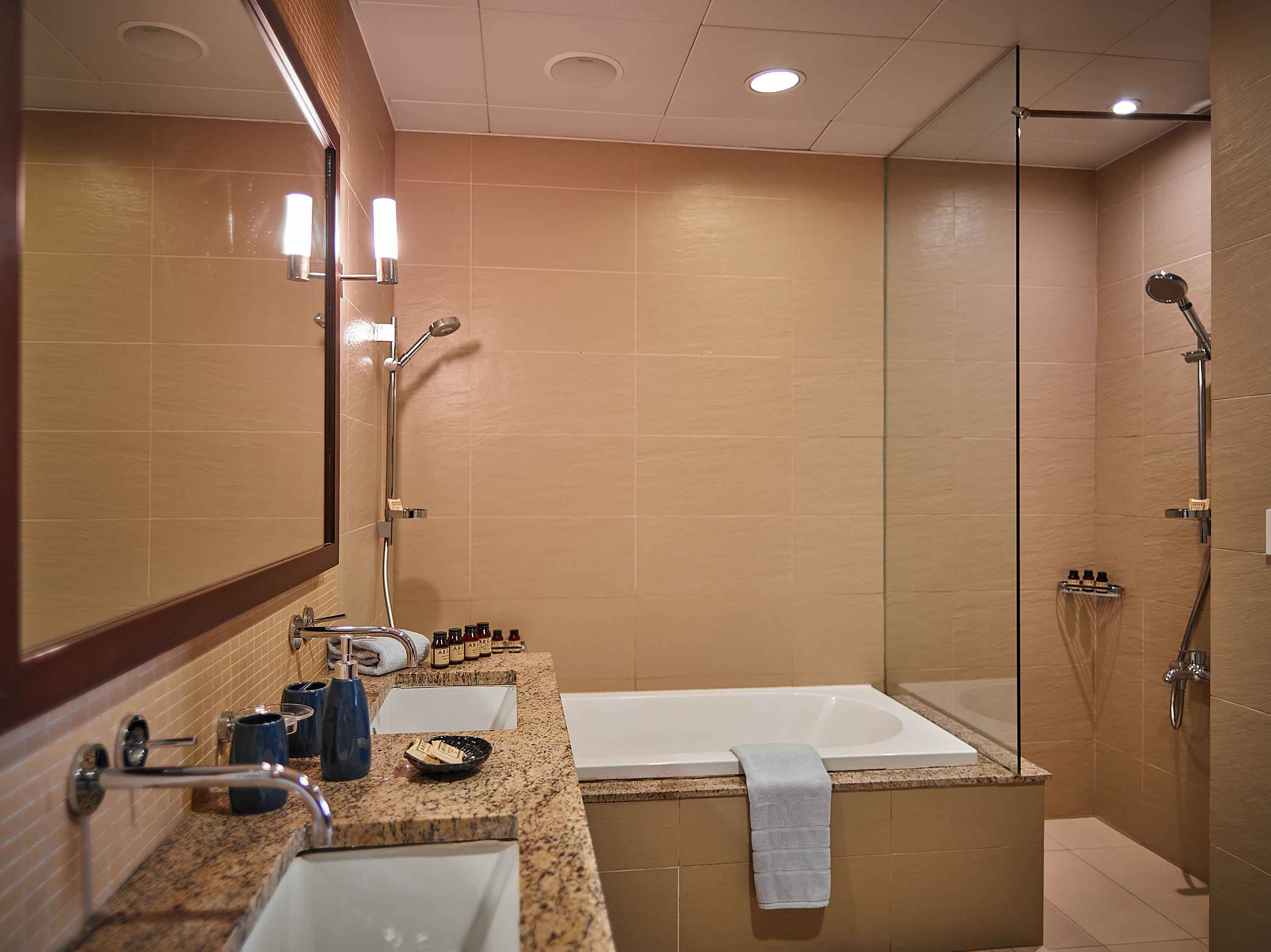 Equipped bathroom at Tiara Tower Apartments