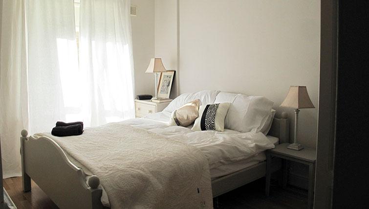 Bed at Pembroke Square Apartment
