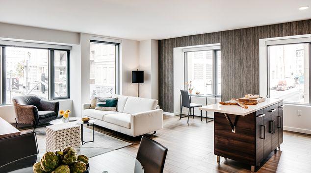 Living room at 150 Van Ness Apartments