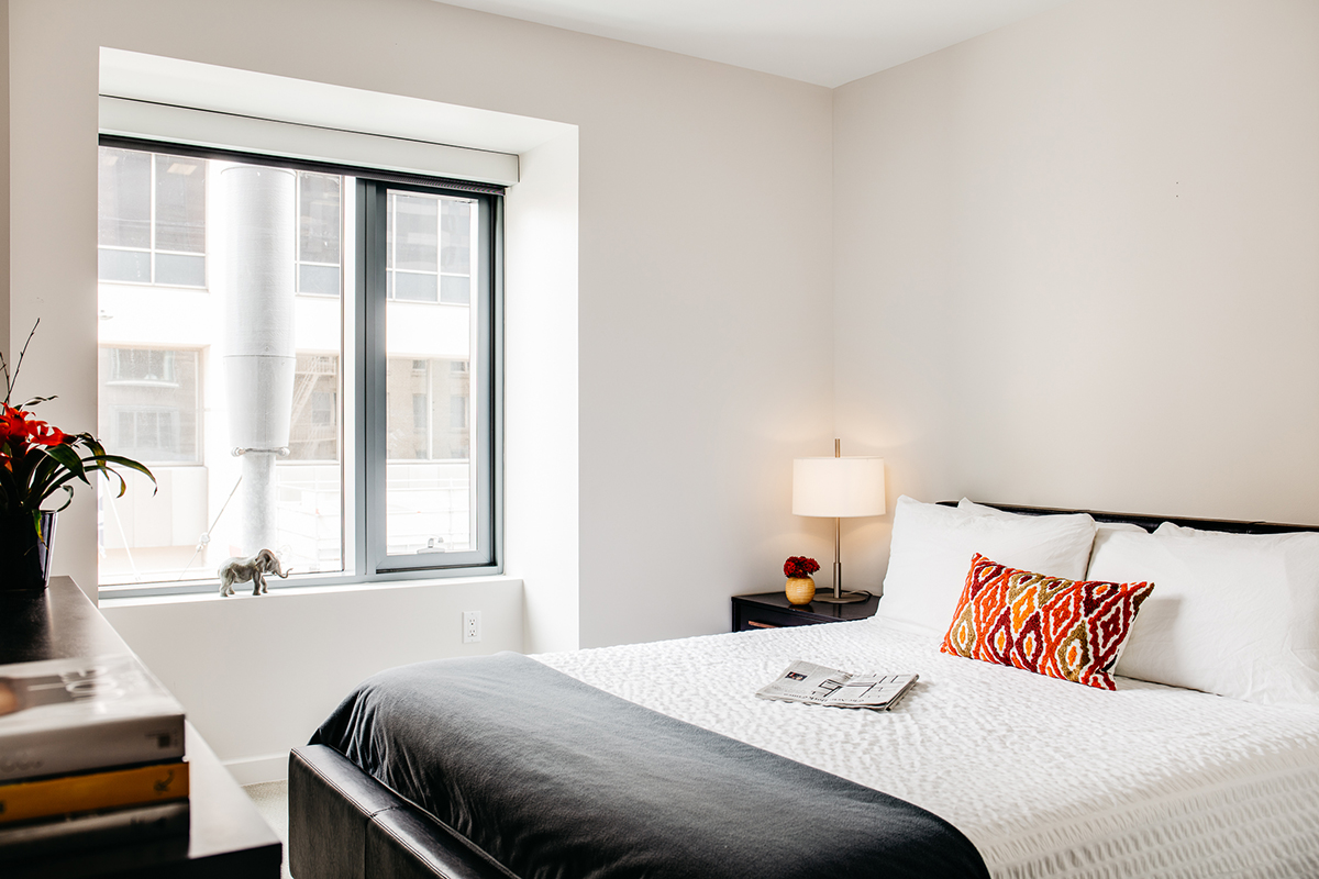 Modern bedroom at 150 Van Ness Apartments