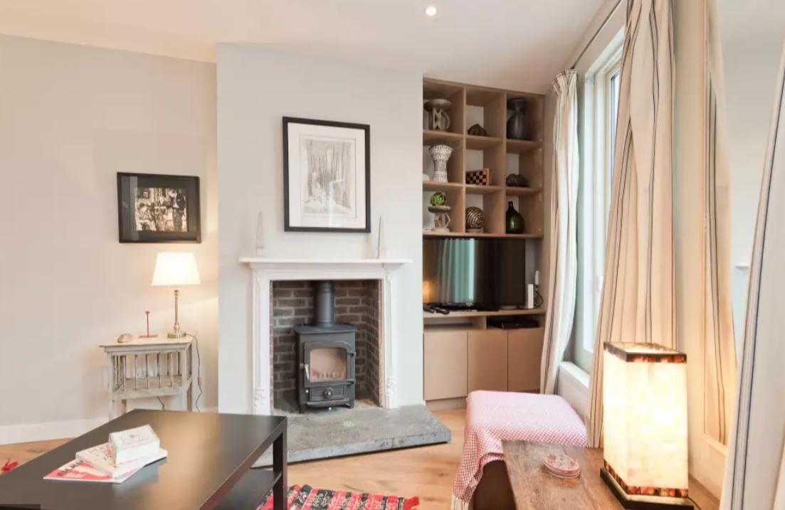 Fireplace at Modern Gran Canal Apartment