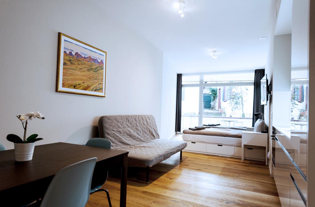Spacious living area at Marktplatz Apartments
