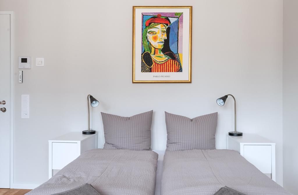 Cosy bedroom at Marktplatz Apartments
