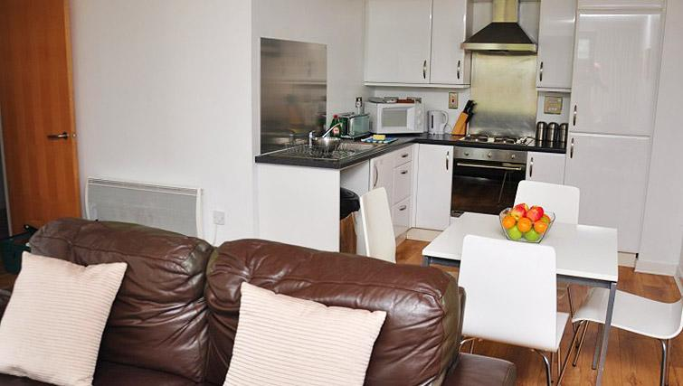 Living area/kitchen at Ocean Serviced Apartments