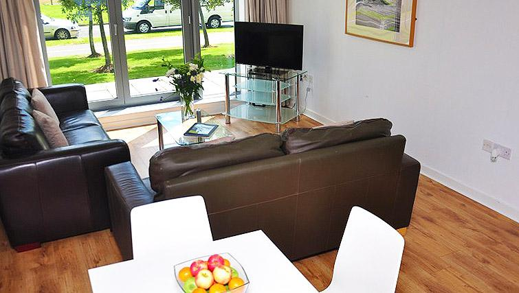 Bright living area at Ocean Serviced Apartments