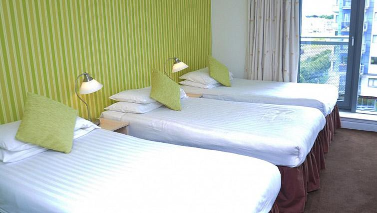 Triple bedroom at Ocean Serviced Apartments