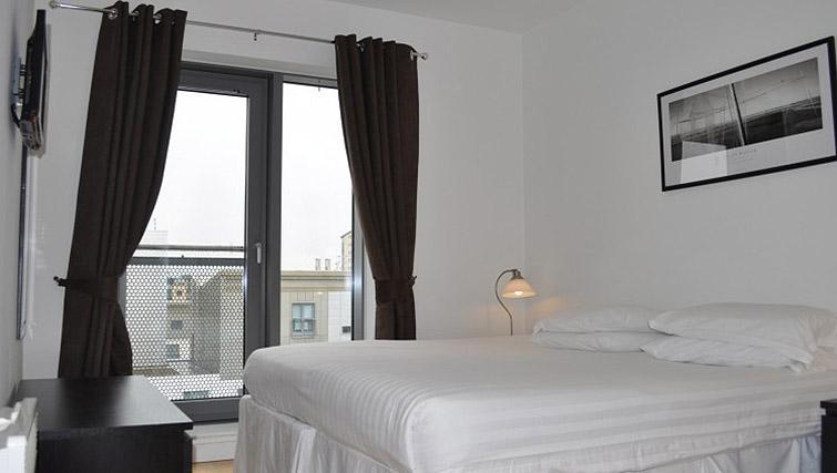 Bedroom at Ocean Serviced Apartments