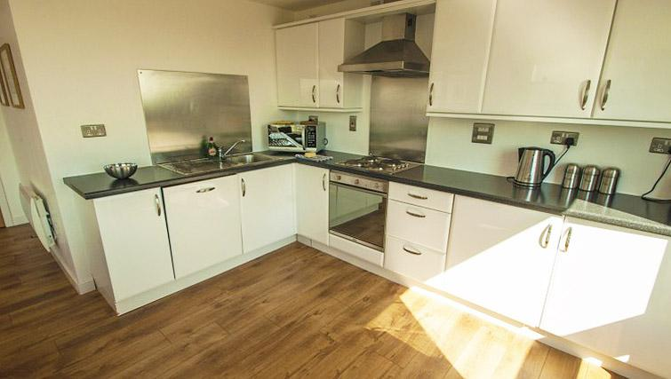 Kitchen at Ocean Serviced Apartments