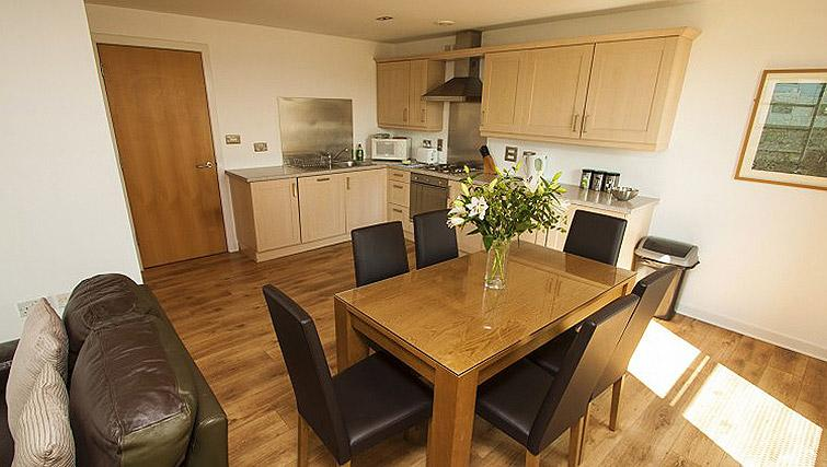 Kitchen/dining area at Ocean Serviced Apartments
