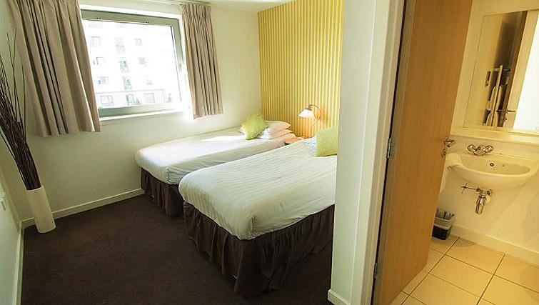 Beds at Ocean Serviced Apartments