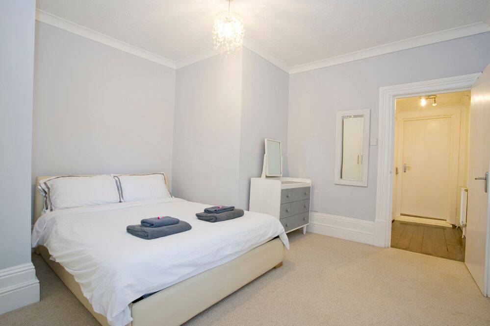 Double bed at Gardens View Apartments