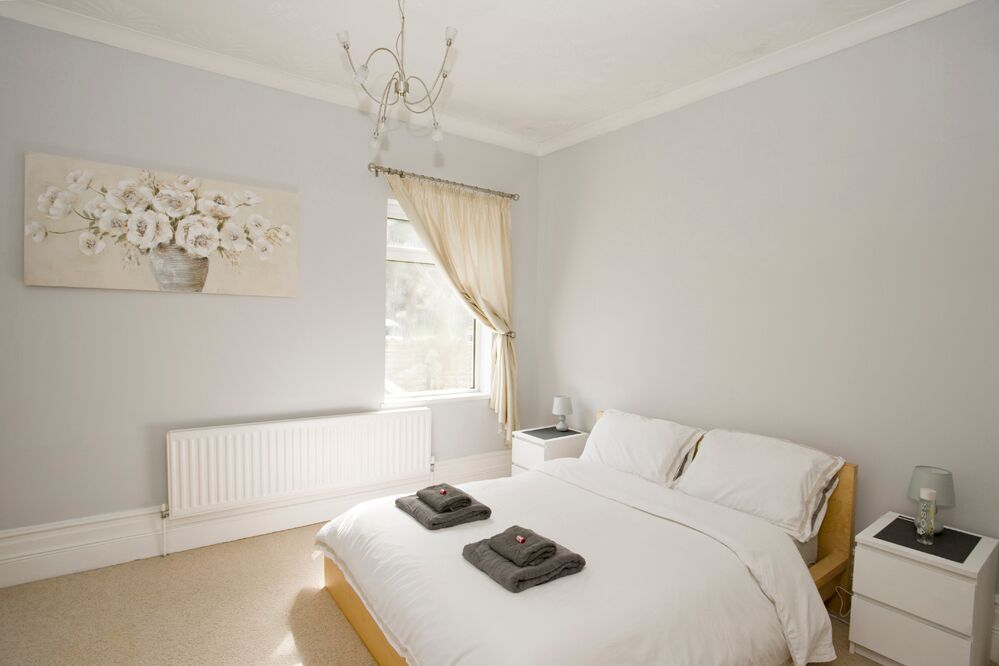 Bright bedroom at Gardens View Apartments