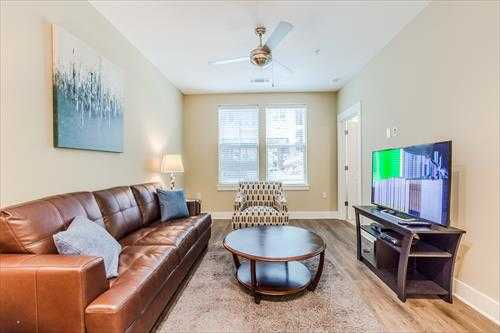 Living room at the Post Centennial Park Apartments