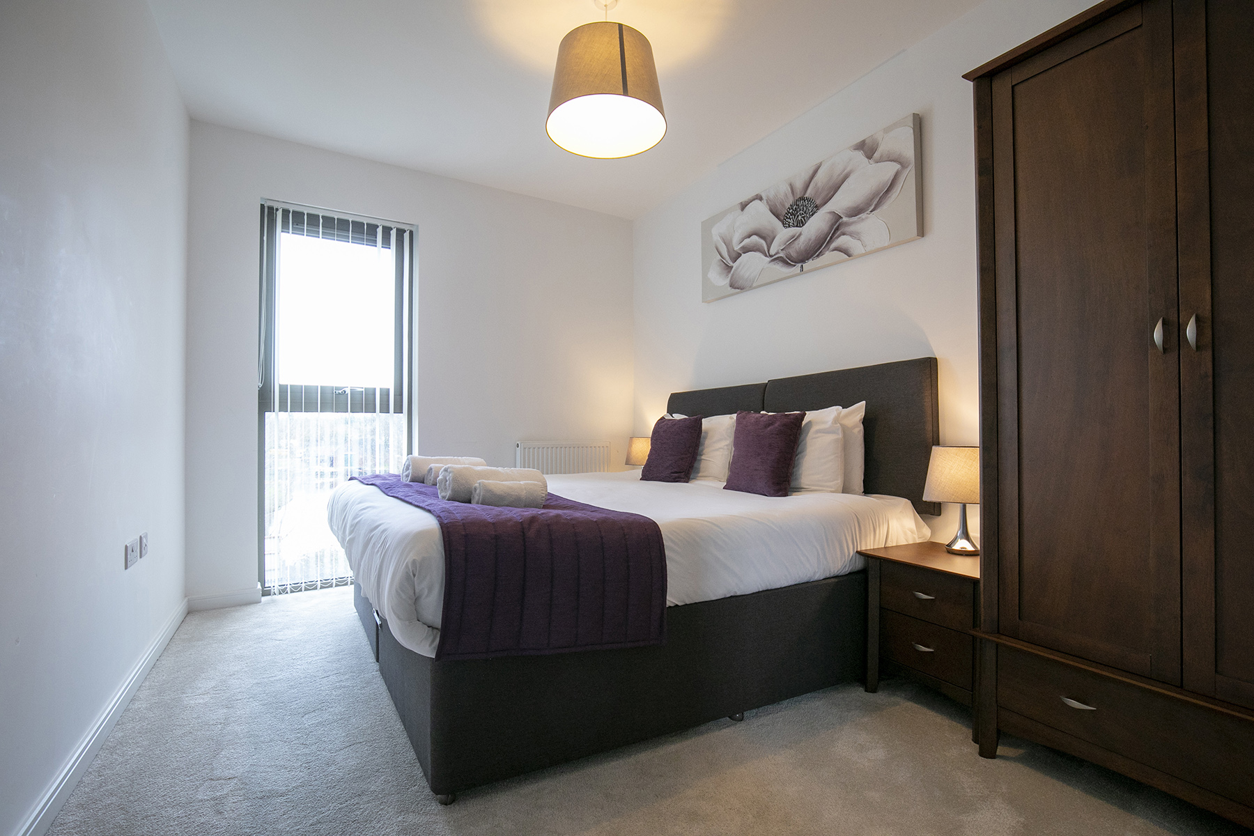 Purple bed at Wey Corner Apartment, Centre, Guildford