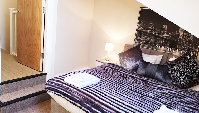 Double bed at Metropolitan House Serviced Apartments