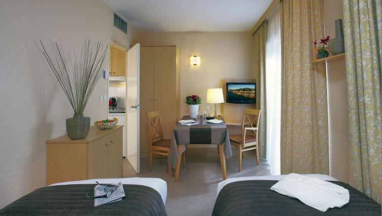 Twin beds in Citadines Prado Chanot Apartments