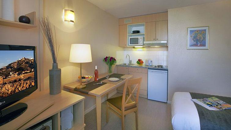 Tidy kitchen in Citadines Prado Chanot Apartments