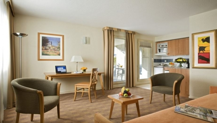 Compact living area in Citadines Antigone Apartments