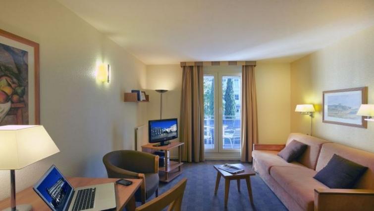 Sophisticated living area in Citadines Antigone Apartments