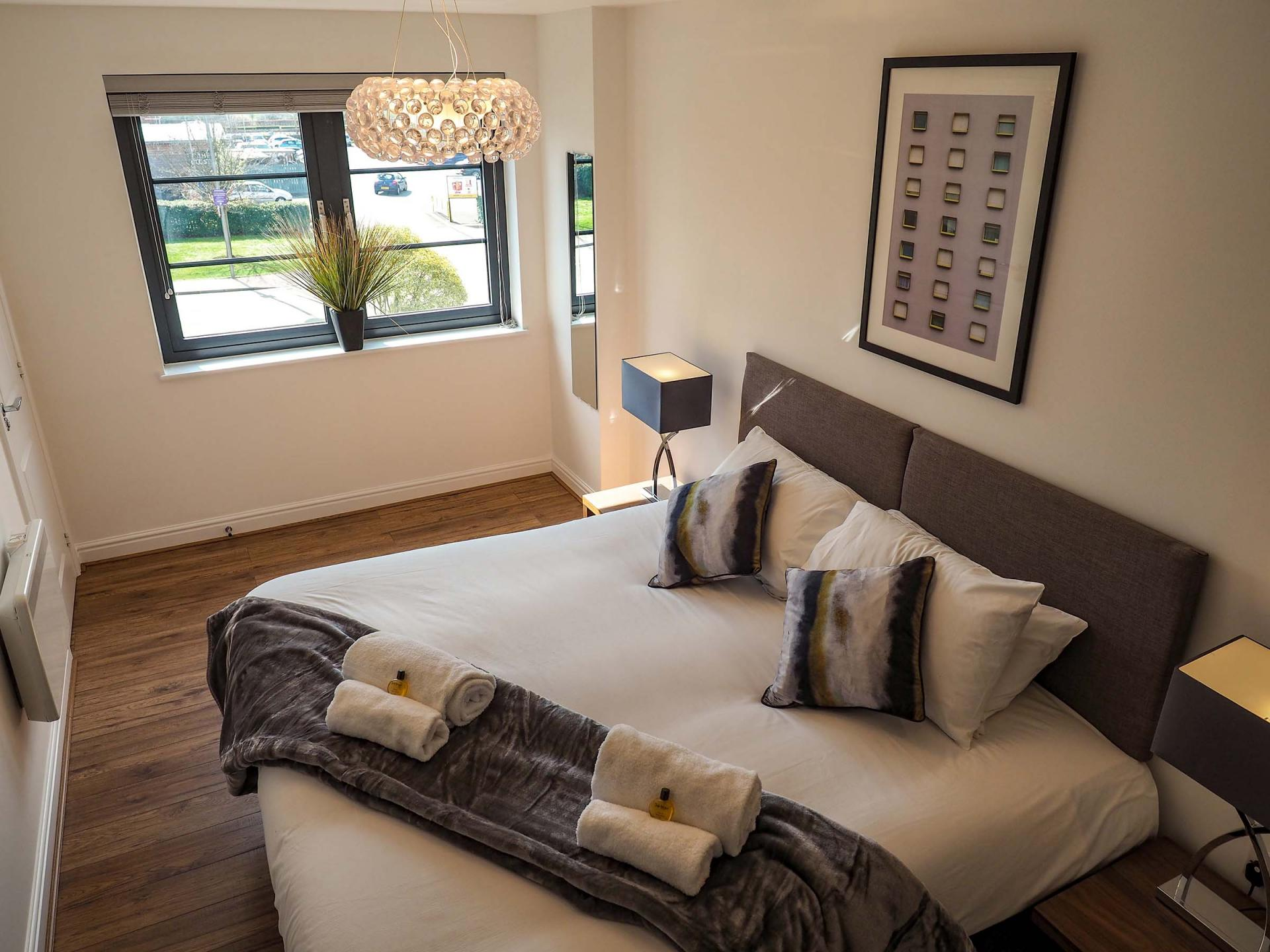 Modern bedroom at Wessex Court Serviced Apartment
