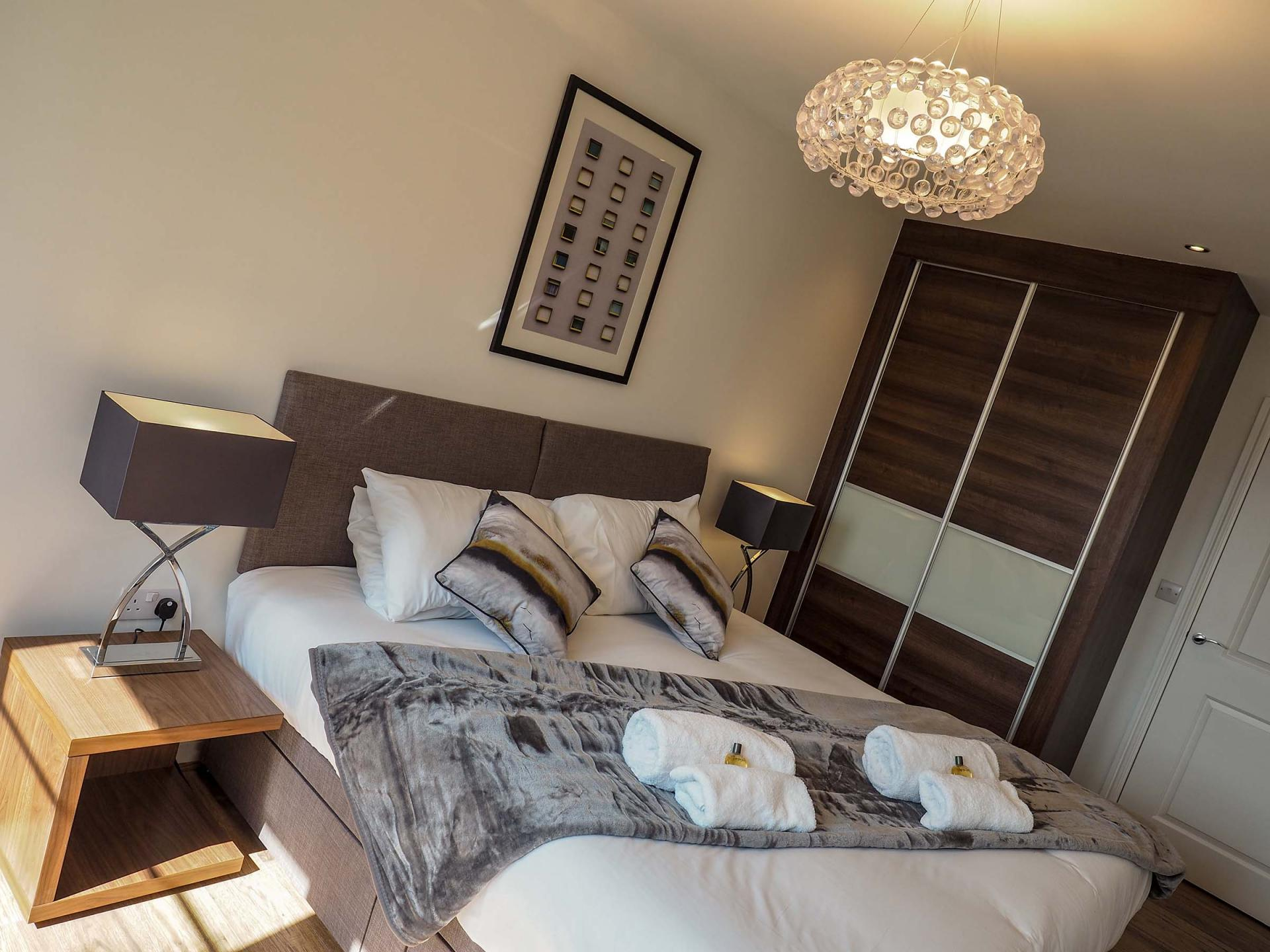 Stylish bedroom at Wessex Court Serviced Apartment